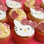 Pink glitter Hello Kitty cupcakes  www.thelittlevillagecakery.co.uk