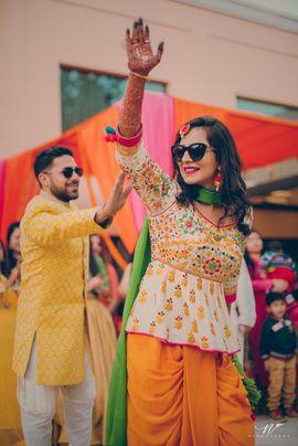 Mehendi Outfits - Peplum White Blouse with Threadwork and Yellow Mustard Dhoti, Net Green Dupatta   WedMeGood #wedmegood #indianbride #indianwedding #peplum #blouse #dhotipants #mehendi #mehendioutfit