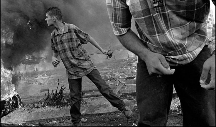 http://d2jv9003bew7ag.cloudfront.net/uploads/Larry-Towell-ISRAEL.-Ramallah.-West-Bank.-Palestinian-demonstrators-in-clash-with-Israeli-soldiers.-One-child-has-just-thrown-a-rock-with-a-home-catapult-2000-detail.jpg