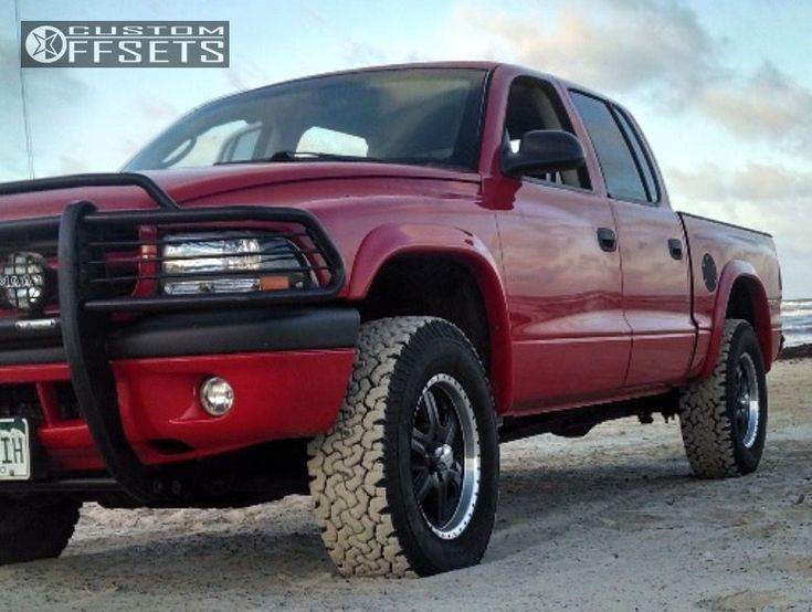 2002 Dodge Dakota 4WD is running American Racing N/a 17x8 +0 wheels BFGoodrich All Terrain TA KO2 265/70 tires with Custom Leveling Kit suspension, needs No trimming and has No rubbing or scrubbing. As you can see from the pics this wheel and tire combo can be done!** With this year/make/model, the stance is Flush. Also remember spacers impact fitment, this ride is running None in front and None in rear.