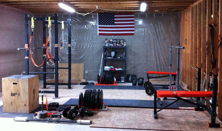 This amazing looking garage gym photo has it all free weights kettle bells barbells jump boxes and weight mats