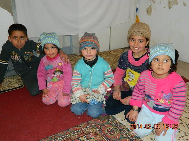 Some of the Syrian children with there knitted hats from Sweden