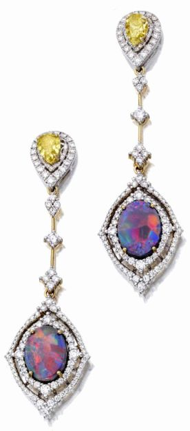 Black opal, fancy colored diamond and diamond jewelry  A pair of day/night pendant earrings en suite, set with two oval cabochon black opals, weighing an estimated total of approximately 6.07 carats, and fancy yellow pear-shaped diamonds, each weighing 1.01 carats.
