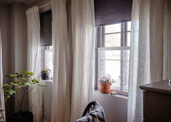 Using curtains lets you adjust light, privacy and they work really well to help insulate a room. By using two light curtains and a darker coloured pull down blind you get a good control of all three things.