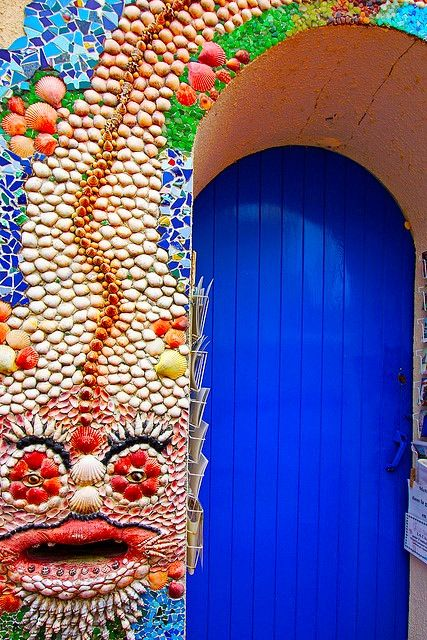 extaordinary mosiac surrounding bright blue door ....never mind the mosaic, I LOVE