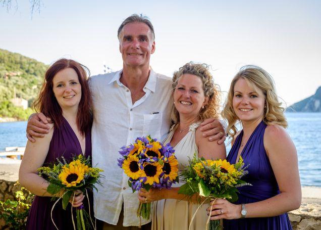 N&L Wedding in Meganisi Greece | sunflower wedding bouquets | Sunflower and purple iris wedding flowers