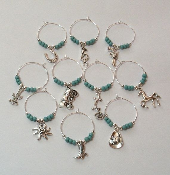 Wine charms are a great way to help your guests identify their glass at your next gathering.  This wine charm set would make a perfect gift for someone with a Southwestern themed wedding, also makes a great gift for a new homeowner.  This set is made wth up to 10 different southwestern themed charms: Horseshoe Kokopelli Pistol Cactus Covered wagon Gekko Horse Sun Boot Hat  This set can be made as an 8PC or 6PC set as well. Select your size in the drop down menu and include in the notes which…