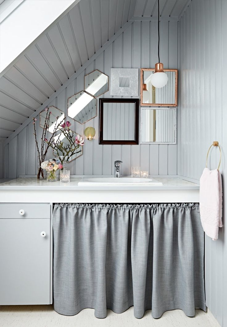We love this small bathroom with mirrors in different shapes and sizes.