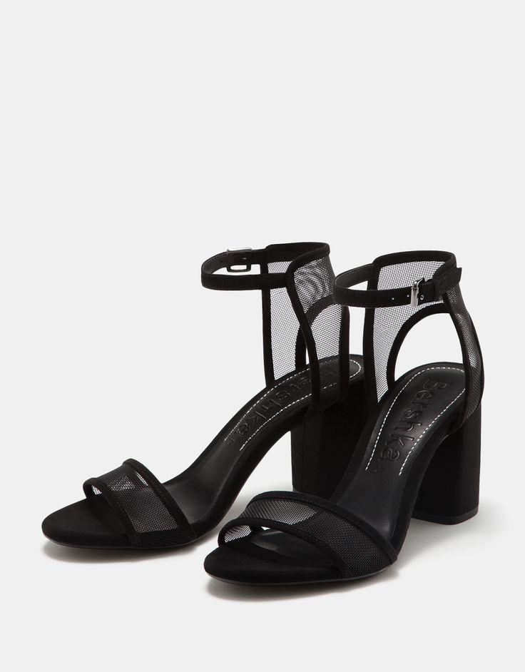 Sandalia tacón medio de rejilla con pulsera. Descubre ésta y muchas otras prendas en Bershka con nuevos productos cada semana