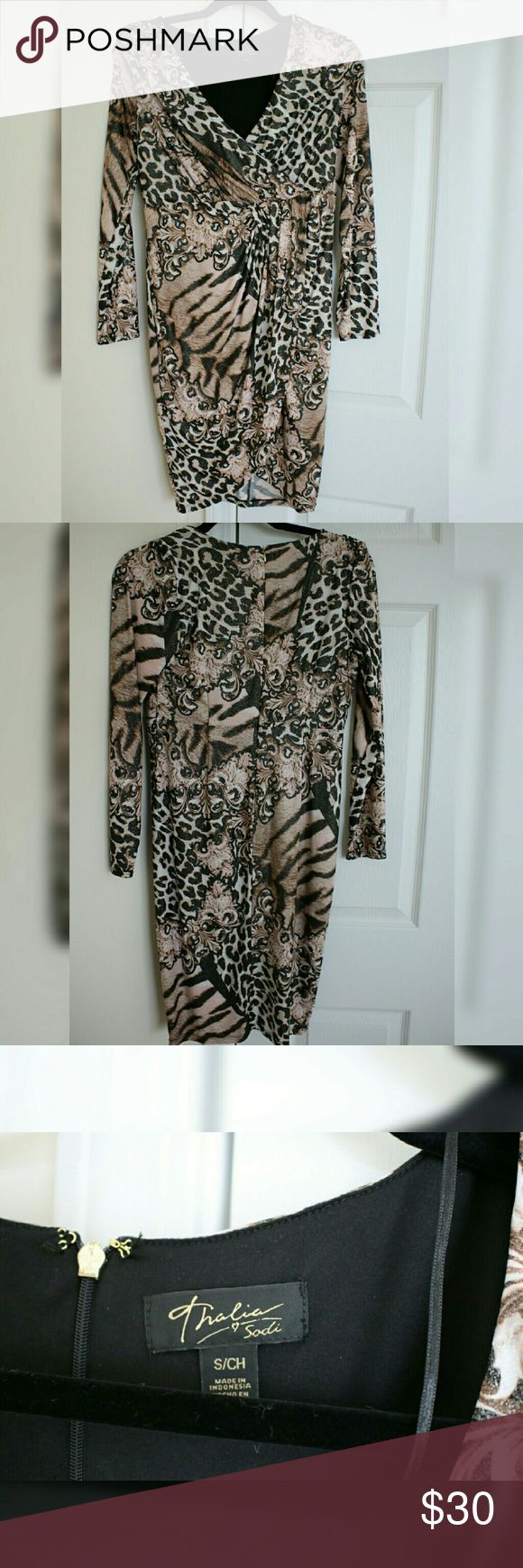 Animal print thalia sodi dress Animal print long sleeve dress with zipper closure. Only worn once. Excellent condition! Macy's Dresses Asymmetrical