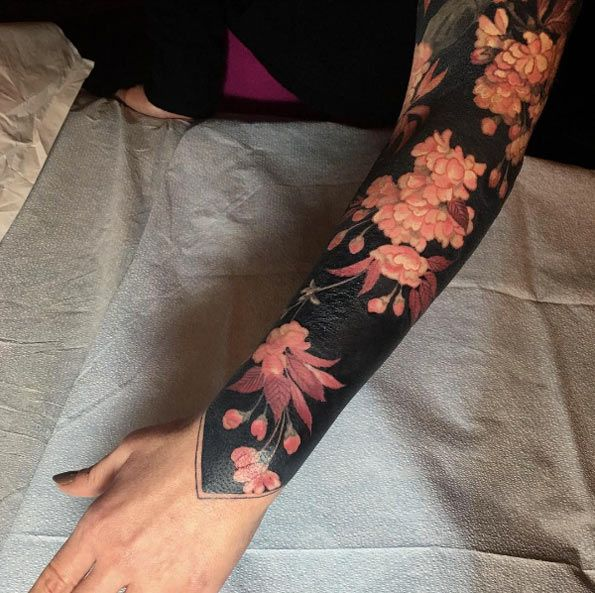 Heavy blackwork sleeve with pink flowers by Esther Garcia