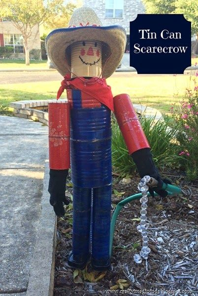 My DIY Tin Can Scarecrow! A cute scarecrow to help in the garden. Fun to make with recyclables! Scarecrows aren't just for Fall.