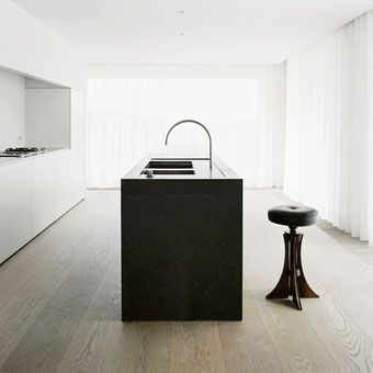 love John Pawson  the subtle use of materials for large surfaces contrast with the black island form that sits in the centre of the room