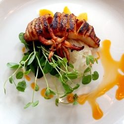 Grilled Calamari with pickled fennel, orange segments, pea shoots and spicy chorizo oil. BLD Restaurant in Toronto, Ontario.