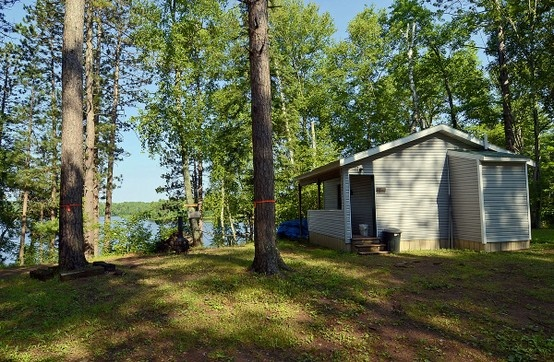 Set in the tall pines of Northern Wisconsin http://clamlakewi.com/bearcabinrentallowerclamlakewi.htm