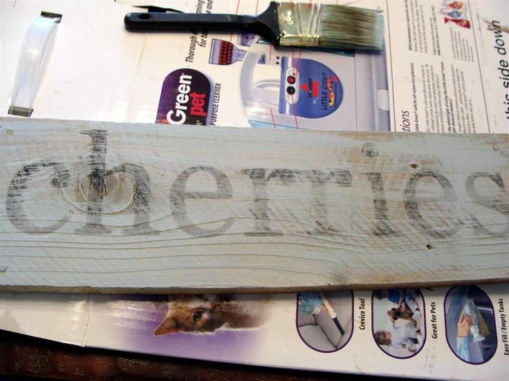 Distressed wooden sign writing technique.  Choose your saying and font, type it... use a mirror image flip from a photo editing app to flip the image, print it out on your printer, it should be backwards.  When you lay it face down on the wood it will appear correct... lightly wet a brush and brush on to dampen the image, use a blunt object like a spoon to apply pressure and rub the ink onto the wood.