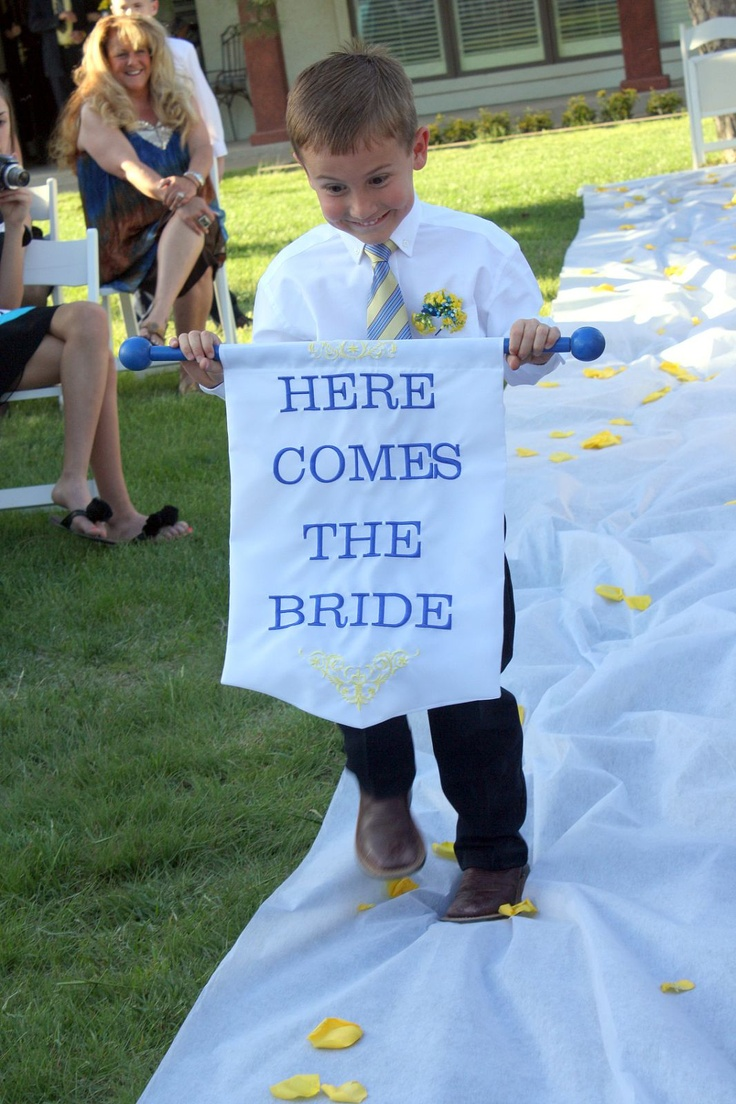 """My adorable nephew carrying my """"Here Comes The Bride"""" Banner :) #wedding"""
