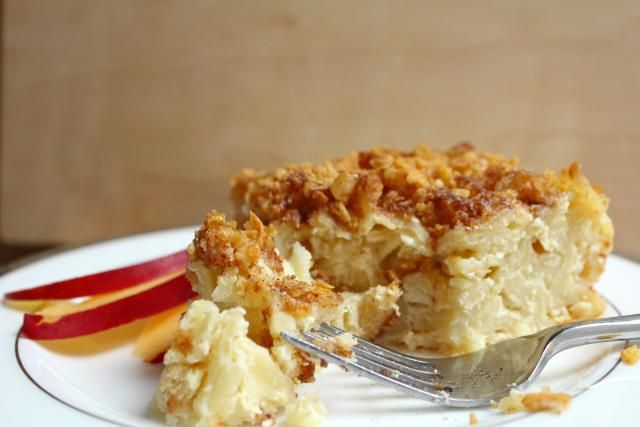 A recipe for Cottage Cheese Noodle Kugel, made with egg noodles, cottage cheese, sour cream, and a cinnamon-sugar cornflake topping.
