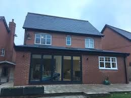 Image result for real slate lean to roof extension with velux windows