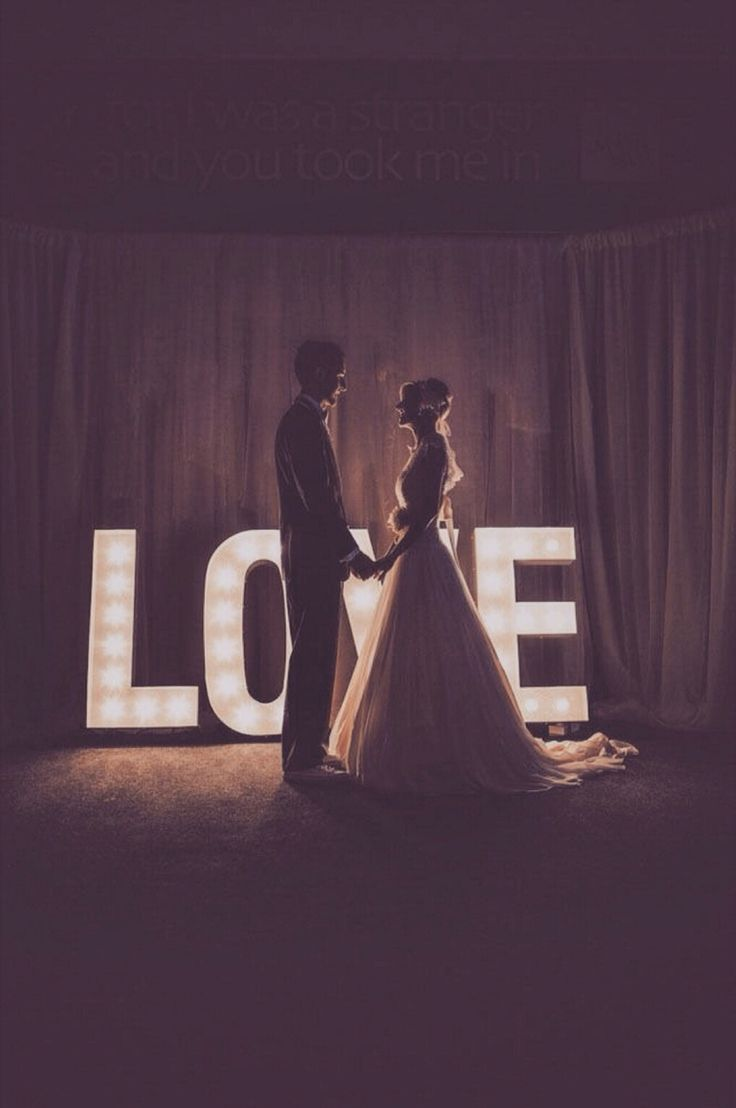 LOVE marquee sign at the reception sets