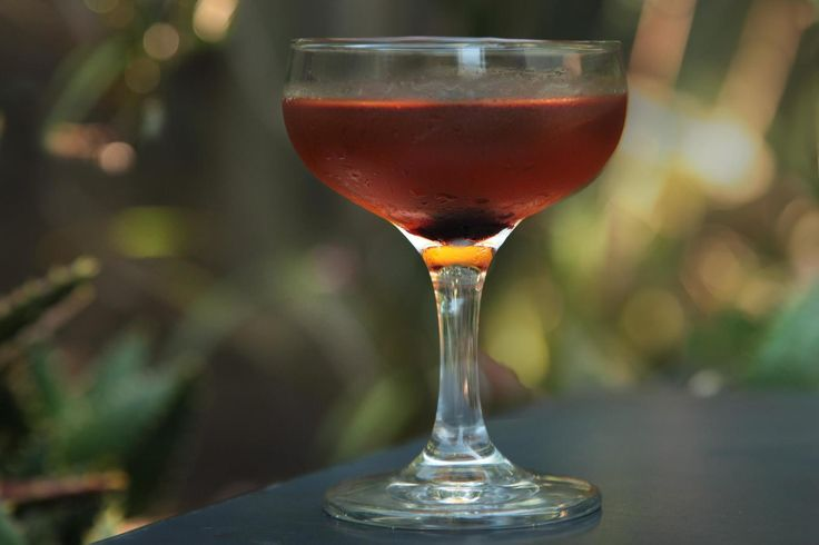 Equal parts sweet and dry vermouth mixed with rye whiskey.