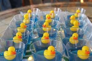 Blue jello with a rubber duck in a clear glass. Great for baby shower