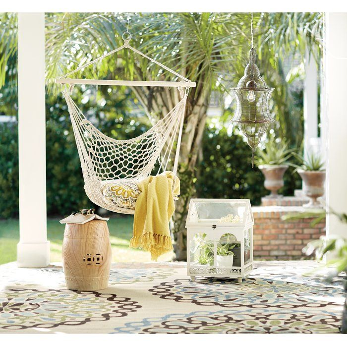 Defined by a simple recycled cotton design and spreader bar, the lovely Parker Woven Tree Hammock Chair lends a breezy touch to your outdoor ensemble. Hang it from a tree branch in the back yard for a charming seat to lounge on warm and sunny days, or hang it from a sturdy beam on your veranda to give guests a fun seat while everyone waits for the burgers to grill. For an added touch of comfort, just nestle a Sunbrella pillow in this hammock. For a cohesive look, try picking a color that…