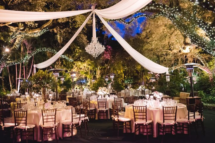 Love the chandelier and the twinkle tree lights outdoor reception wedding at villa woodbine