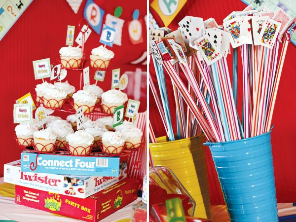 Use empty game boxes for food display....cover in saran wrap:   game-night-party-ideas-decoration