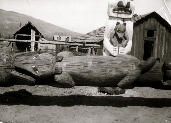 Detail of a Wolf from the Ensnared-Bear pole that was erected ca. 1875.<br><br>This photograph shows this pole lowered as it was recently restored.