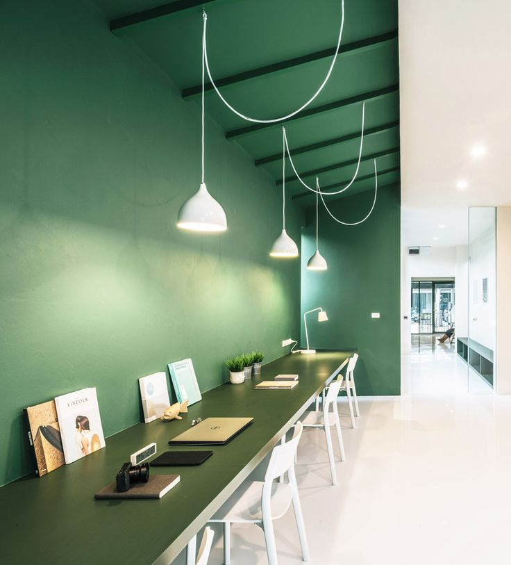 Splashes of green are used throughout this Thai TV production office