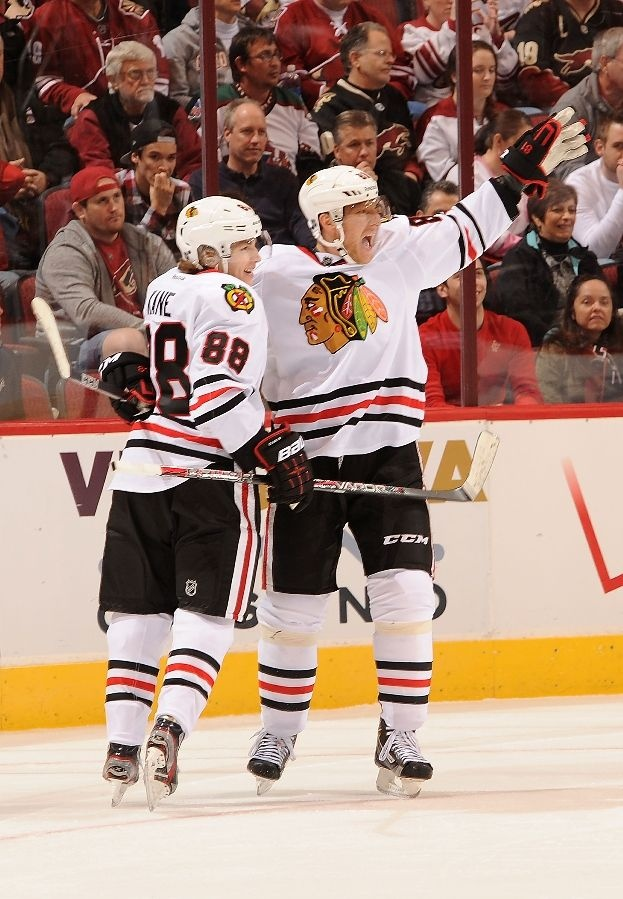 GLENDALE, AZ - JANUARY 20: Marian Hossa #81 and teammate Patrick Kane #88 of the Chicago Blackhawks celebrate a goal against the Phoenix Coyotes at Jobing.com Arena on January 20, 2013 in Glendale, Arizona. (Photo by Norm Hall/NHLI via Getty Images)