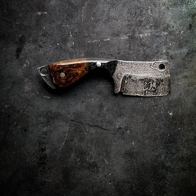 """ØX, the Northman word for axe This small brute is ideal for every-day-carry and for enforcing your will. Perfect for taking a mans thumb, or popping tops if your kicking back to blow the frost off a few. ØX Mini Cleaver - SOLD S35vn steel Cryo treated OAL 5.75"""" Blade Length 2.5"""" Bocote / Carbon fiber handle Leather Sheath Included #knifegrinding #knivesdaily #knifeporn #bladesmith #knives #edc #everyday_tactical #everydaycarry #cleaver #beavercleaver #merica #metalwork #leatherwork #mad..."""