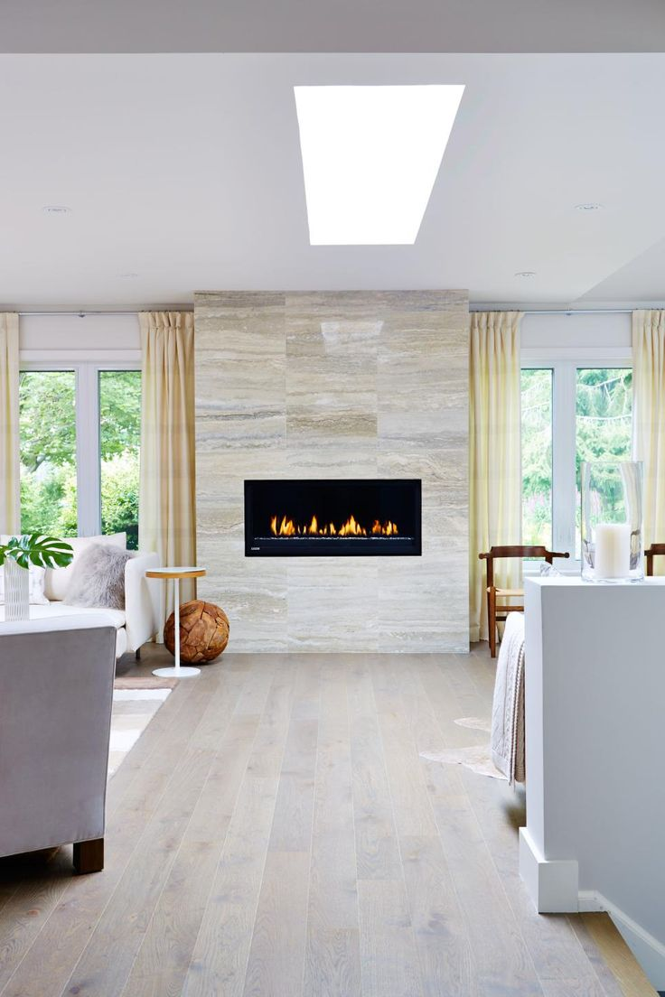 As seen on season 1 of Sarah Sees Potential, designer Sarah Richardson replaced an old, ugly fireplace with a chic, contemporary model and custom limestone tile surround.
