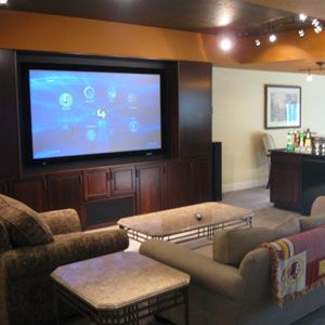 A Projection Screen Multiroom Music Control4 System And More Comprise This Media Room