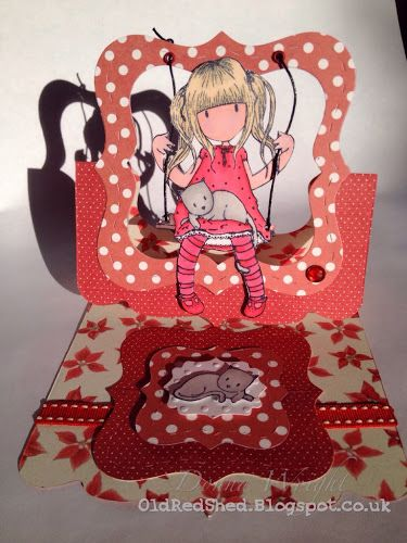 Donna Wright using the Square Pop 'n Cuts Base and the Labels & Stitched Frames Framelits for a fun Flying Easel Card - Old Red Shed: Gorjuss girl stitched framelits card...