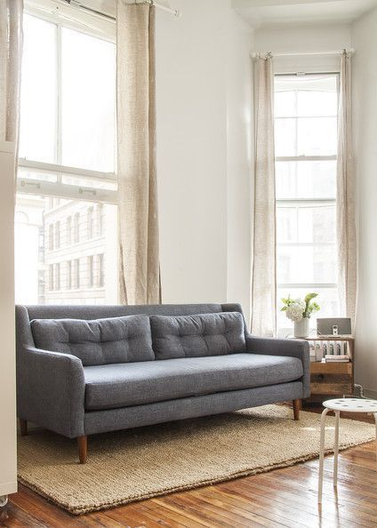 This space is so beautifully decorated with pretty accents along with nice color on the walls. I love the paint which I find inspiring. A chambray Crosby sofa by West Elm | Lonny