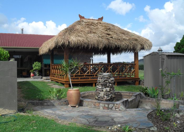 Bali hut instantaneously gives a resort ambiance to any for Pool hut designs