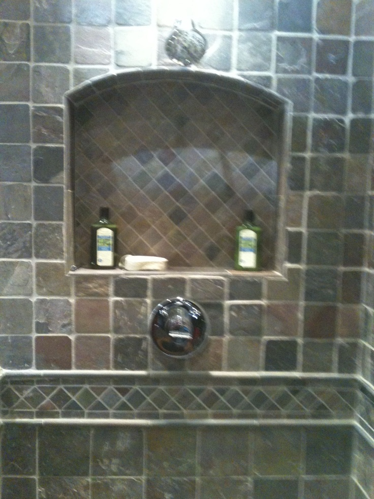 Inset Shower Shelf With Stone Tiles.