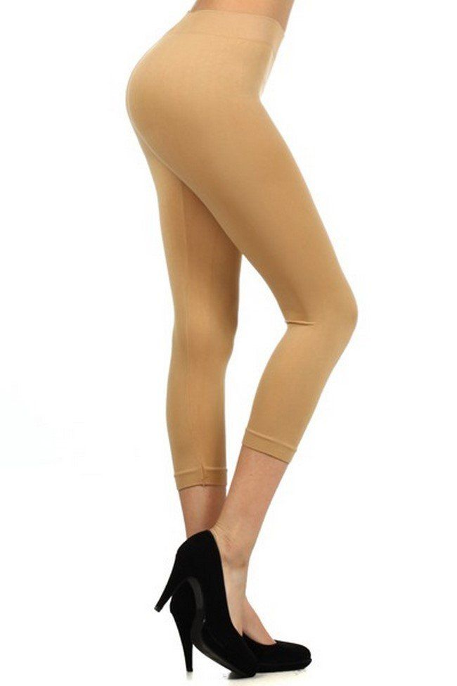 """Yelete  Women basic solid color seamless capri leggings. Soft to the touch, The perfect leggings that can be worn at the gym or for a nice casual day out. Depending on height, the capri will stop right below the calf, mid calf or upper calf. •One size fit most 5'5""""-5'11"""" •Colors: Suntan, Brown, Taupe •Hand wash, hang dry •92% Nylon 8% Spandex"""