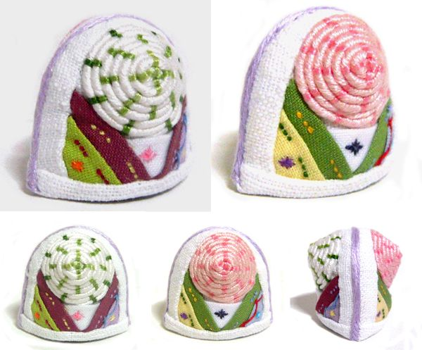 This item is a thimble in Korea. It's a very unique. It is available not only sewing but accessary. It's made of cloth but it's very hard. Needle head never prick your finger. It will protect your fingers from needle.  http://rimkimstudio.blogspot.kr/2013/11/thimble-korea-traditional-sewing_30.html