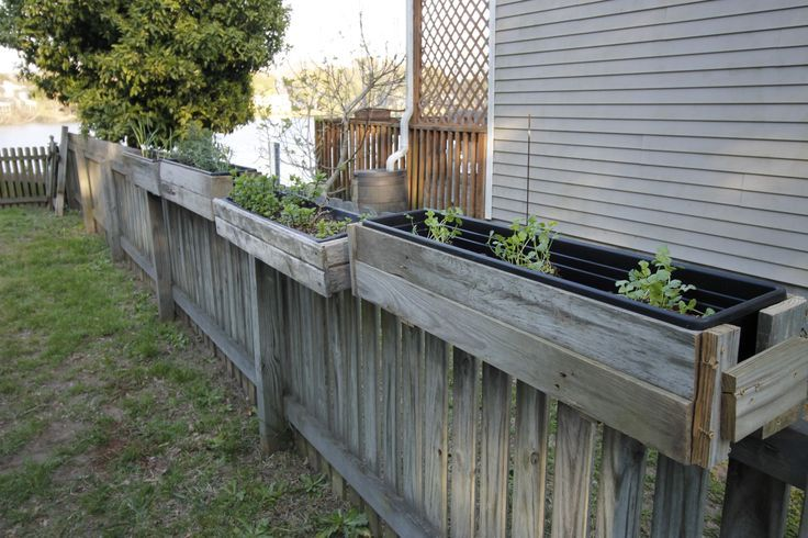 How to used old wood fence posts to build DIY Hanging Fence Planters - Charleston Crafted