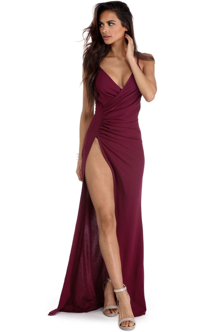 """<p><strong>Special Occasion</strong></p>  <p>No mortal man will be able to resist your charm in our enticing Leda dress! She features a wrap V neckline, thin shoulder straps and a ruched side detail. She has a beautiful floor length skirt with a high side slit as well as a hidden back zipper closure.</p>  <p><em>Model is 5'6 with a 32"""" bust, 23"""" waist and 34"""" hips. She is wearing a size small.</em></p>  <p></p>"""