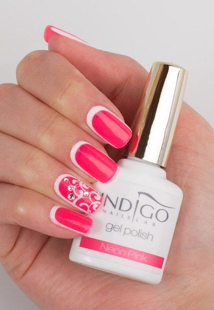 """Catchy """"reverse French"""": perfectly smooth gel-lacquer coating of neon pink on a white background combined with a clear shape and equal length of nails shows a serious attitude to the image. This design clearly distinguishes you from the crowd, draws attention to you. Gentle drawing decorated with rhinestones gives you additional showiness. Manicure for the spring-summer period."""