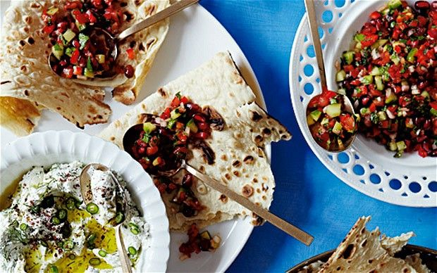 Turkish salad  of tomato, cucumber, pepper, chilli, herbs  with thick garlicky yogurt to eat with flatbread.