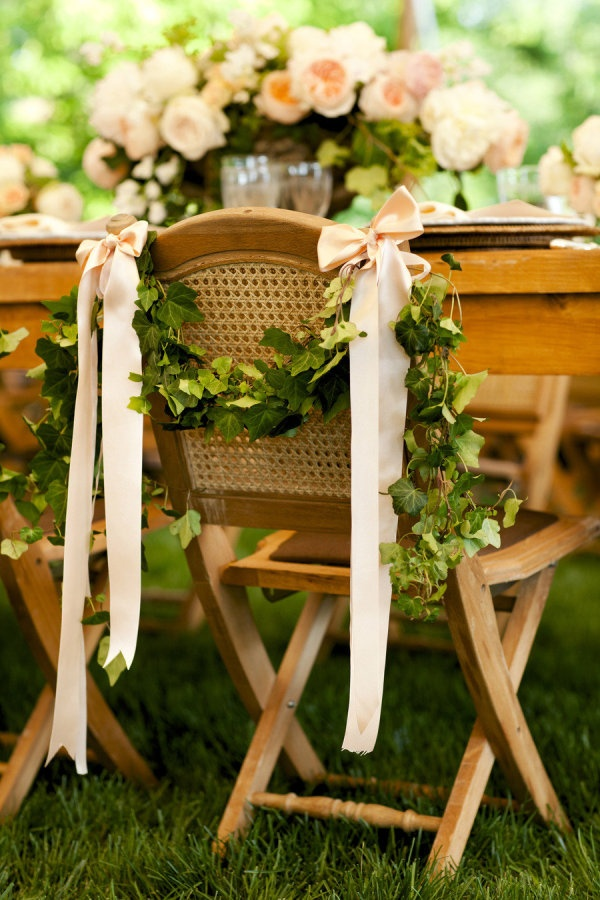 Chair garland tied up with satin ribbon.