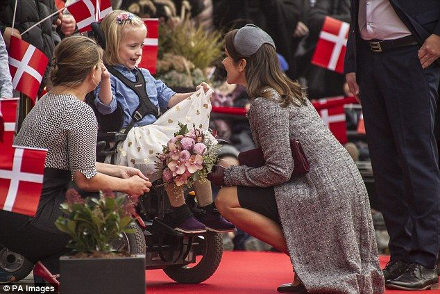 All smiles: Always one to take the time to meet her fans, the Princess accepted a bunch of flowers from a little girl in a wheelchair and posed for photos with a number of the children
