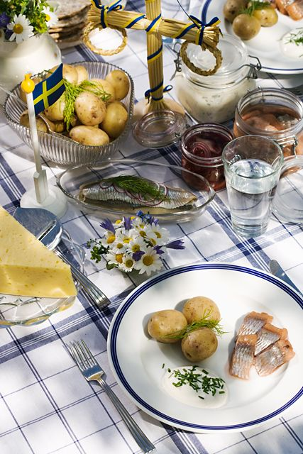 Swedish midsummer buffet-if I understand this correctly, pickled herring, new potatoes, sour cream, dill, strawberries?
