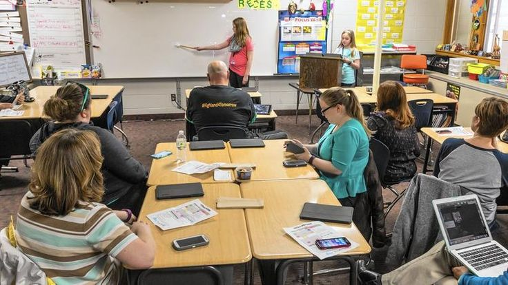 IN: Fifth-graders took over the teaching duties to explain the intimidating new world of social media and apps to Highland's teachers.