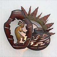 NOVICA Iron candleholder, 'Kokopelli's Dance' by NOVICA. $59.95. Painted by hand in warm colors Kokopelli dances and plays a song for the sun. A prehistoric image this deity is usually depicted with a humped back playing a flute. Legends suggest Kokopelli was a Toltec trader who traveled from central Mexico to the southwestern deserts and mountains of the U.S. where he is featured in the form of rock art dating back thousands of years. J. Blas depicts him with pottery on a hand...